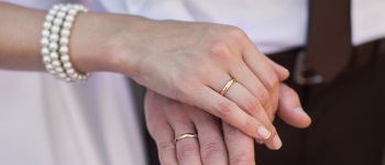 Bride and groom with wedding rings on their hands, male and female hand with wedding rings, wedding ceremony, together forever